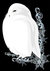 white owl among snowflakes
