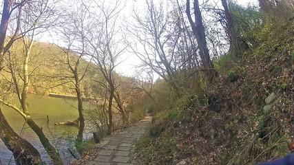 Walking on a trail in mountain near lake.
