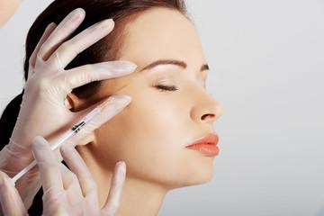 Portrait of woman having cosmetic botox injection