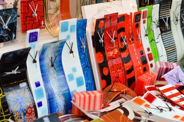 Shopping display of fashionable modern handmade glass clocks