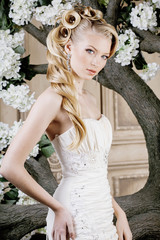beauty young bride alone in luxury vintage interior with flowers