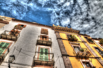 old buildings under a cloudy sky in Bosa
