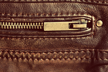 Genuine brown leather with zip and seam. Background