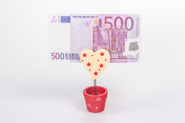 500 euros in holder isolated on white background
