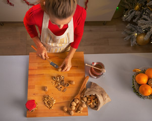 Young housewife chopping walnuts