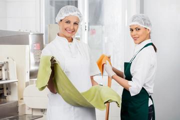 Confident Chefs Holding Spaghetti Pasta Sheets