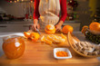 Closeup on young housewife making orange jam