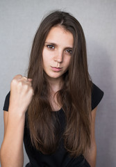 Menacing pretty girl showing her fist