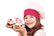 happy little girl cook with raspberry cake portrait