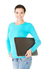Happy woman holding a laptop