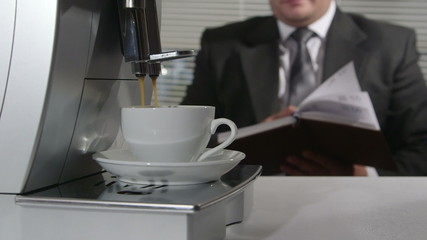 Business person having coffee break with cup of espress