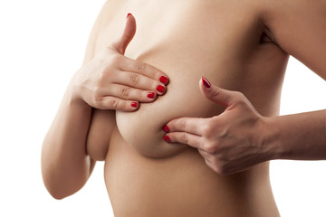 woman checking her breasts with her fingers
