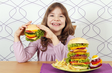 hungry little girl eat hamburger