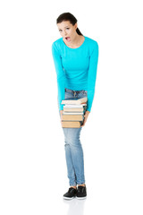 Tired student woman holding heavy books
