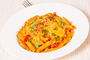 Penne rigate pasta with tomato sauce