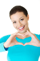 Portrait of happy woman making heart sign