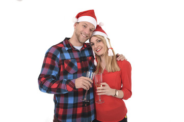 Christmas Champagne toast young beautiful couple in Santa hats