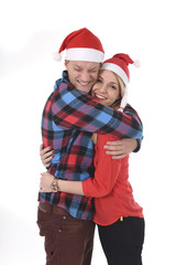 Christmas young couple in Santa hats in love happy together