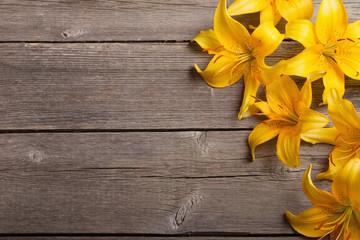 orange lily on wooden background