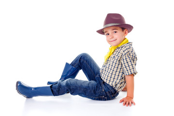 Casual little cowboy in hat