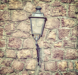 classic lamp in a brick wall in vintage tone