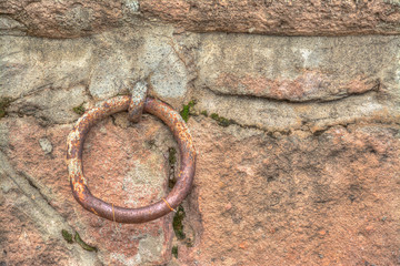 Old metal ring in a rustic wall