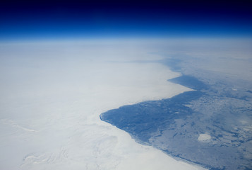 The frozen coast of Newfoundland from high altitude.