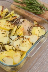 Baked potatoes with chicken and rosemary