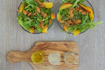 Vitamin salad- rucola with fruits and nuts. Top view