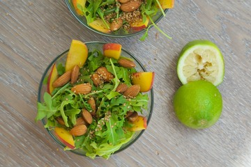 Vitamin salad- rucola with fruits and nuts