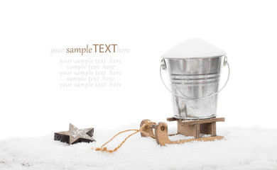 Snow in a bucket on a sled, isolated over white background, with