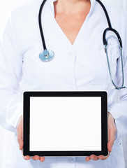 Doctor holding digital display and makes patient diagnosis