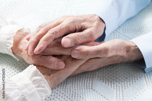 canvas print picture Old people couple holding hands closeup. Happy family.