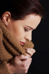 Portrait of a woman wrapped in warm scarf