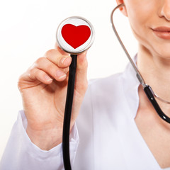 Woman doctor holding stethoscope. Diagnosis of heart medicine