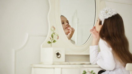 beautiful girl preens in the mirror - dolly shot