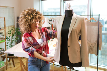 Fashion designer measuring a blazer