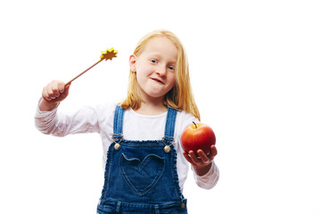Mädchen mit Apfel und Zauberstab