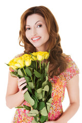 Happy woman holding bunch of roses