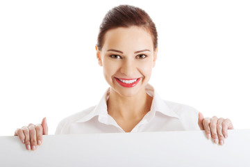 Happy woman holding white empty banner