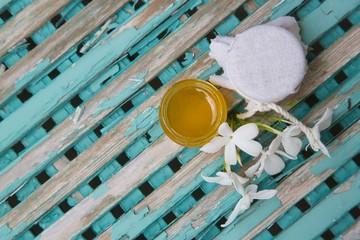 Jasmine honey  in an opened glass
