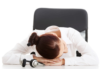 Call center woman taking nap on a desk