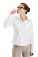 Full length businesswoman drinking water