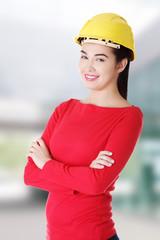 Portrait of confident female worker in helmet.