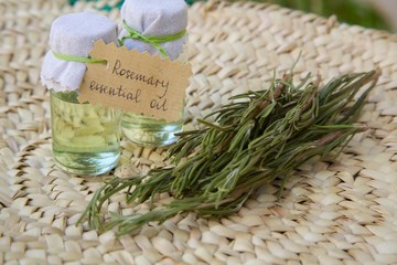 Rosemary essential oil and rosemary twigs