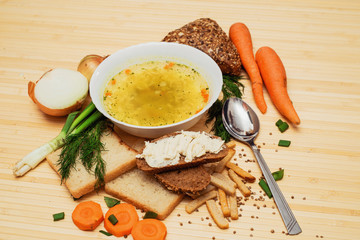 broth with bread and vegetables