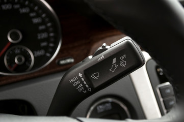 Modern car interior detail. Wipers control.
