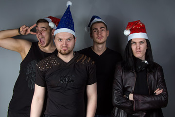 Man's metal band with red and blue christmas hats