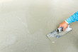 Using float to level surface of concrete - 73530638