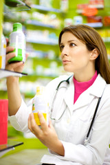 Female pharmacist working with medicine in pharmacy